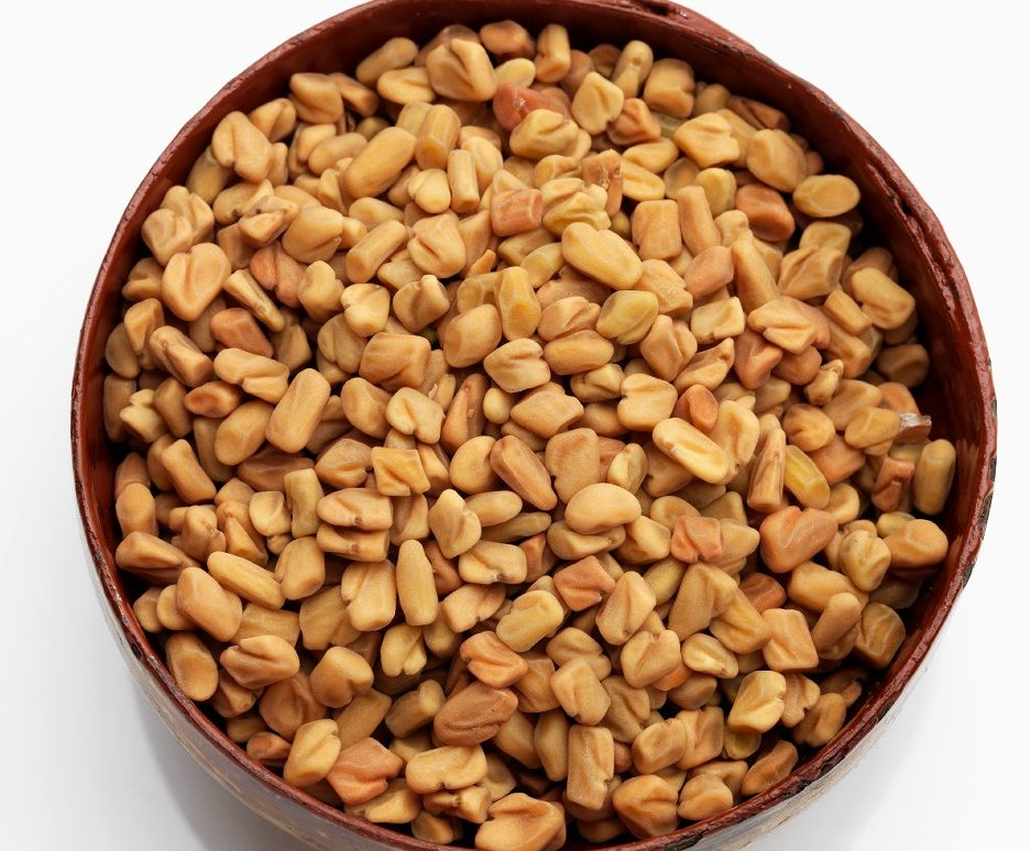 A wooden bowl of fenugreek on a white backgroundReporters / Mainstream_data