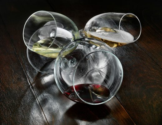 Three wine glasses on a tableReporters / Mainstream_data