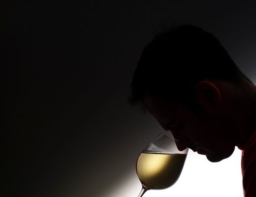 Smelling Glass of White Wine  Reporters / Food & Drink Photos